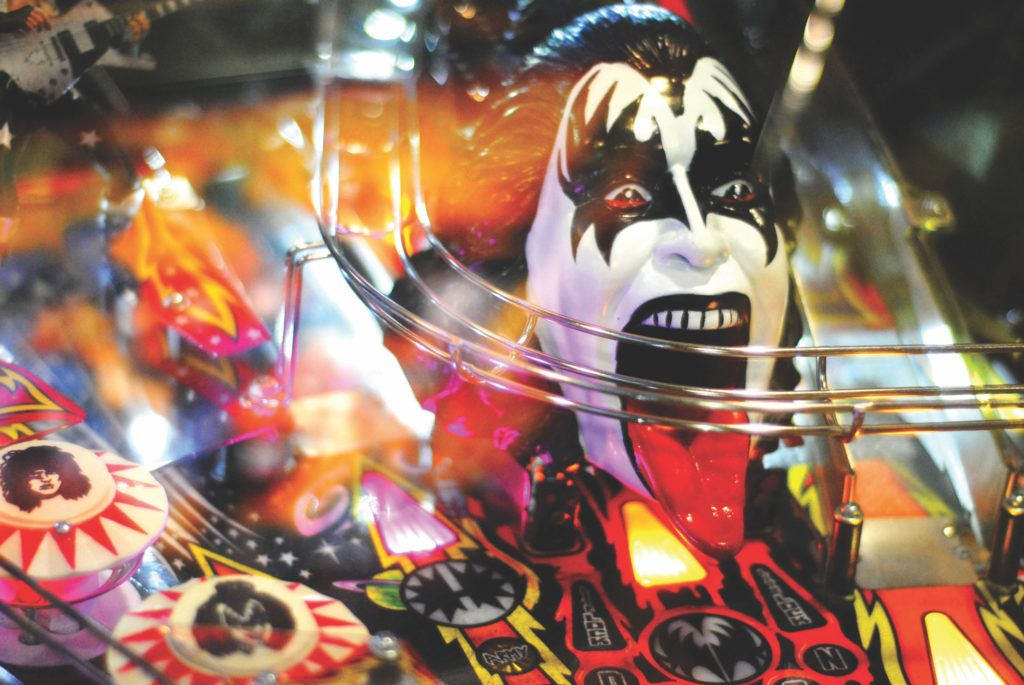 Kiss band head bust figurine on Classic Pinball Machine